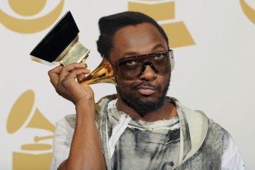 LOS ANGELES, CA - JANUARY 31:  Musician Will.i.am of Black Eyed Peas poses with Best Pop Performace award for 'I Got A Feeling', Best Pop Vocal Album award for 'The E.N.D.' and Best Short Form Music Video for 'Boom Boom Pow' in the press room during the 52nd Annual GRAMMY Awards held at Staples Center on January 31, 2010 in Los Angeles, California.  (Photo by Kevork Djansezian/Getty Images) 96151480